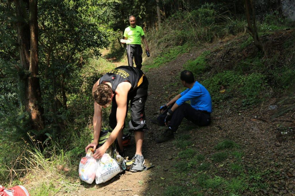 Trashtag Challenge, Hiking Version, Man Picking up Garbage while hiking